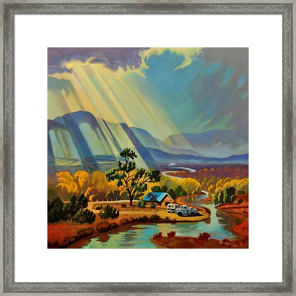 God Rays On A Blue Roof Framed Print