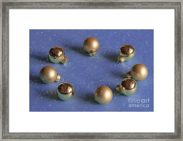 Golden Christmas Balls On The Snowy Background Framed Print