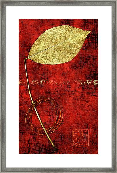 Golden Leaf On Bright Red Paper Framed Print