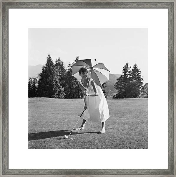 Golfing Hepburn Framed Print