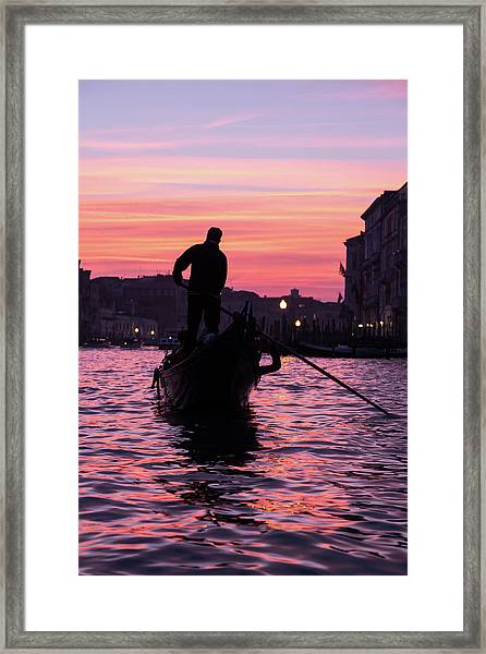 Gondolier At Sunset Framed Print