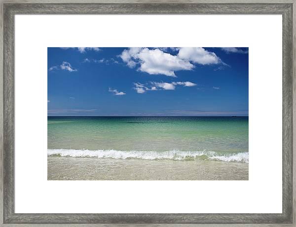 Green Waters Against Blue Sky Framed Print