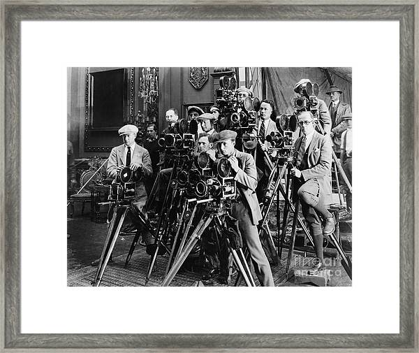 Group Of Photographers Taking Picture Framed Print