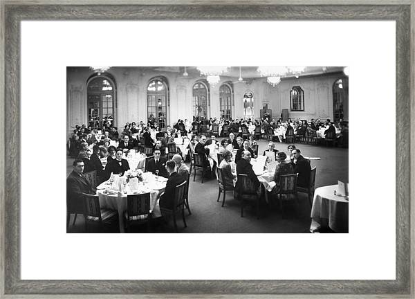 Guests At Dinner Framed Print