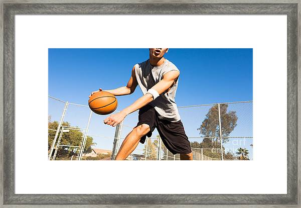 Handsome Male Playing Basketball Outdoor Framed Print