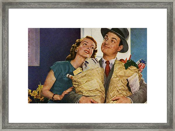 Happy Couple Holding Groceries Framed Print
