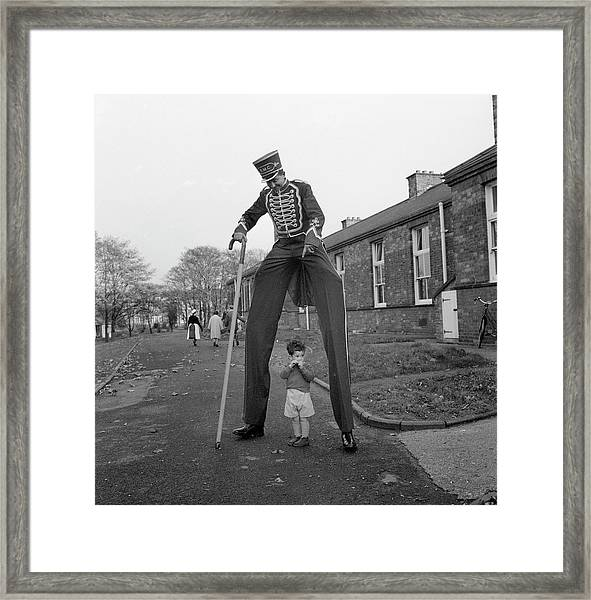 Henry The Stilt Man Framed Print