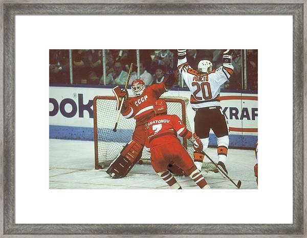 Hockey Fun At Rendezvous 87 Framed Print by B Bennett