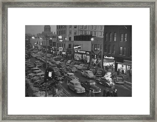 Holiday Traffic Jamming Parking Space In Framed Print