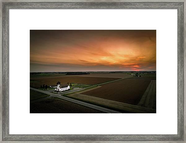 Holy Sunset Framed Print