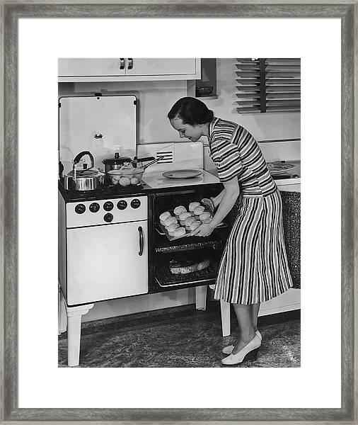 Home Cooking Framed Print by Fpg