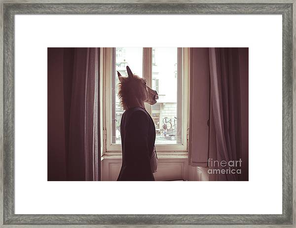 Horse Mask Man In Front Of Window At Framed Print