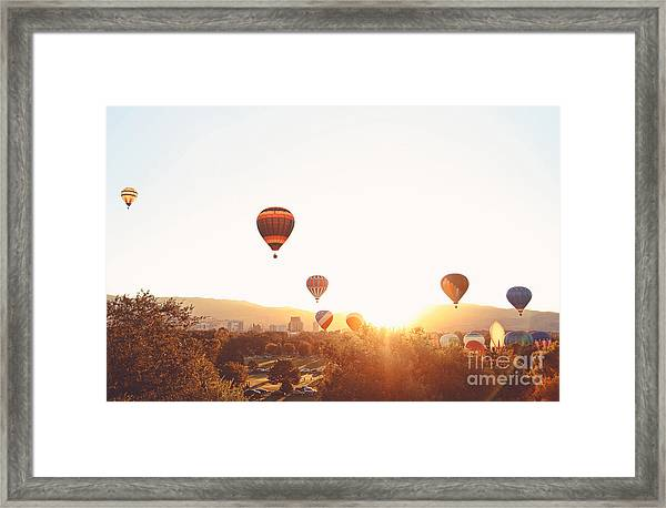 Hot Air Balloons In The Sky During Framed Print by Annette Shaff
