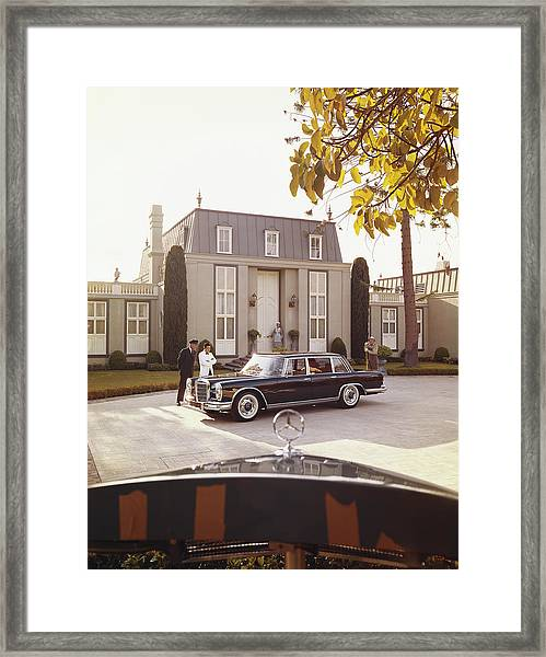 House Workers And Staff Looking At Car Framed Print by Tom Kelley Archive