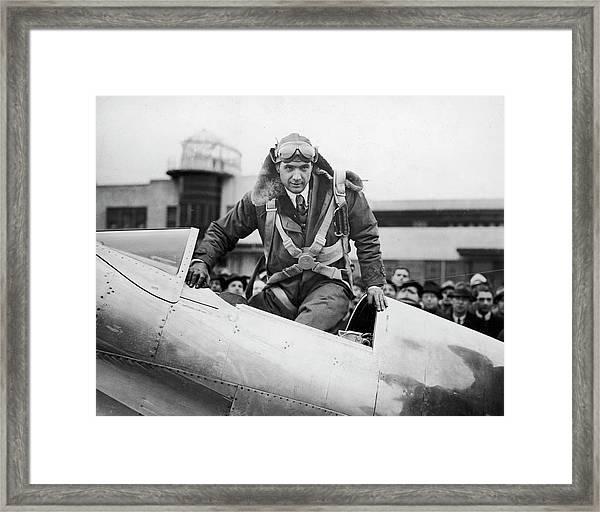 Hughes Boards His Plane Framed Print