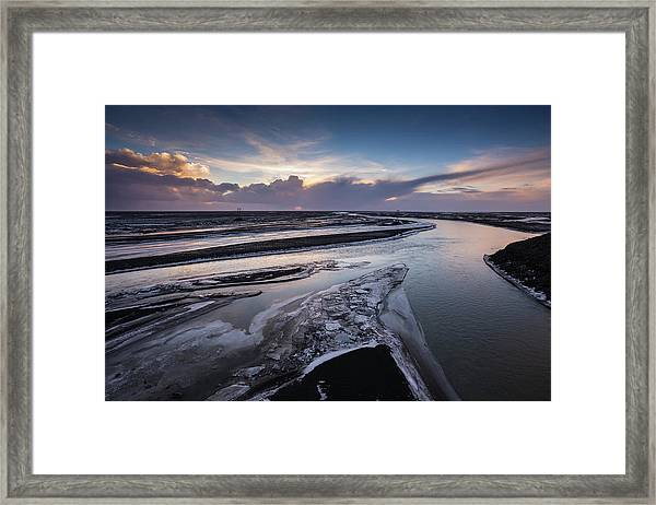 Icy River Channels At Sunset Framed Print