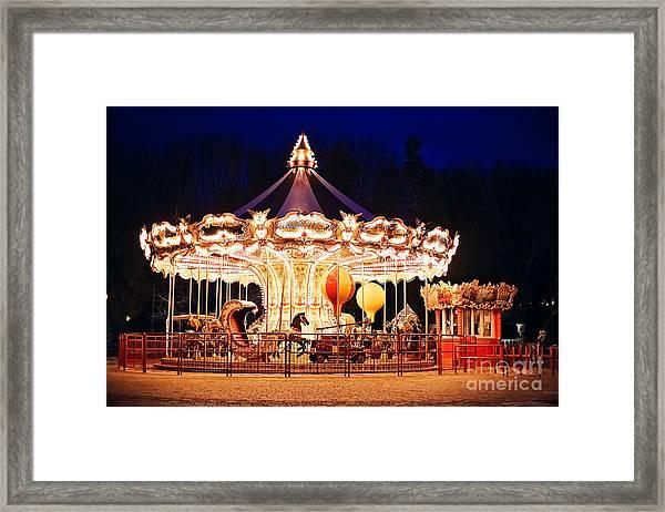 Illuminated Retro Carousel At Night Framed Print