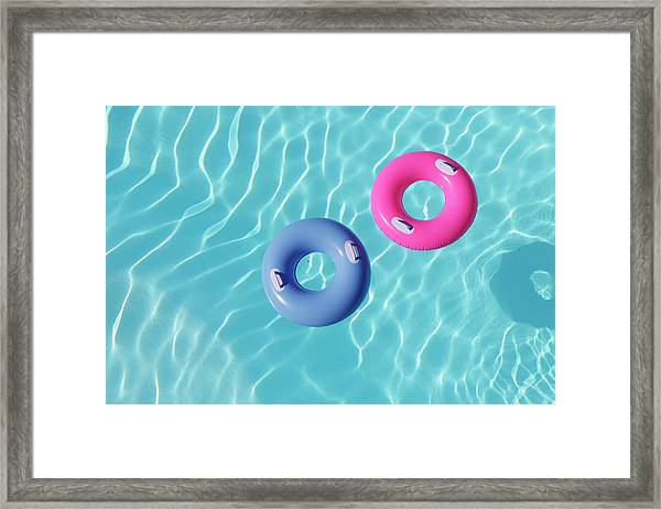 Inflatable Rings In Pool Framed Print