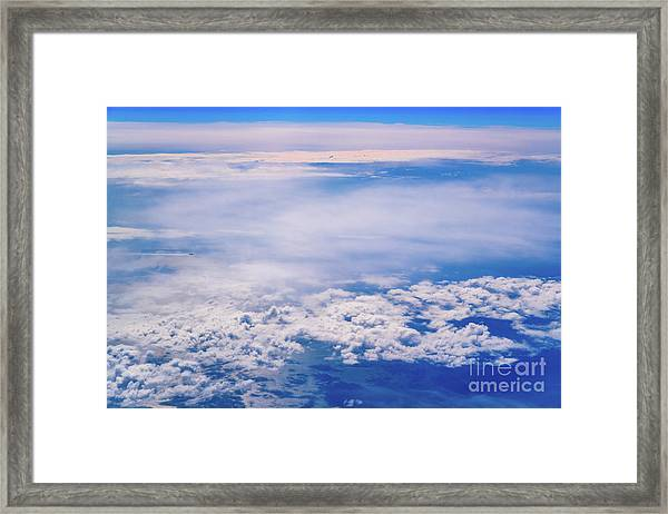 Intense Blue Sky With White Clouds And Plane Crossing It, Seen From Above In Another Plane. Framed Print