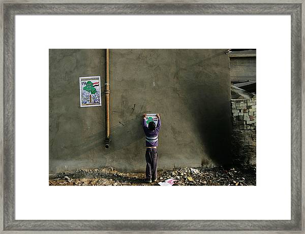 Iraqi Shias Hang Political Posters Framed Print