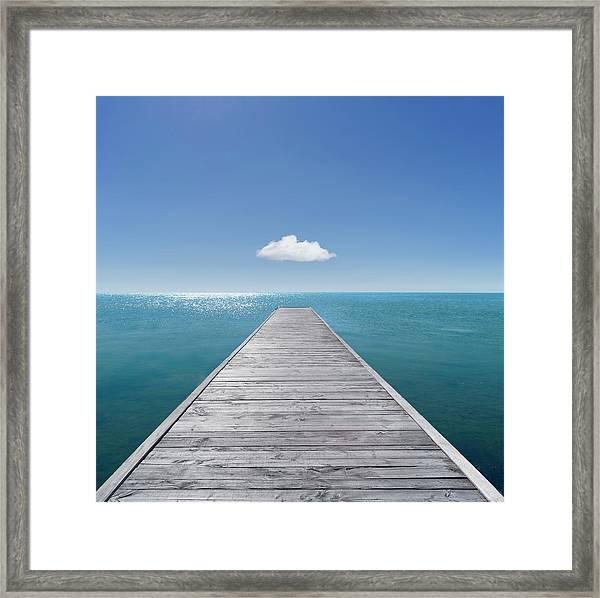 Jetty Into The Horizon Framed Print