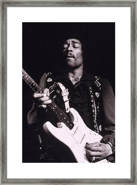 Jimi Hendrix Performs Framed Print