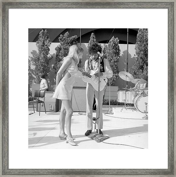 Jimi Hendrix With A Muse Framed Print by Michael Ochs Archives