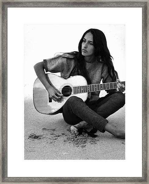 Joan Baez Playing Guitar On The Beach Framed Print by Ralph Crane