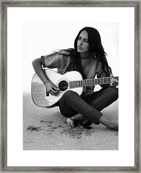 Joan Baez Playing Guitar On The Beach Framed Print