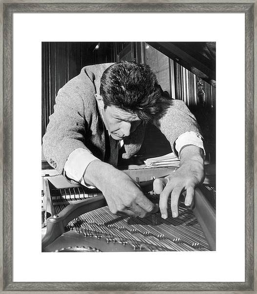 John Cage Tunes A Piano Framed Print