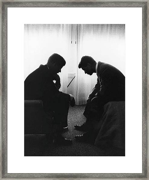 John Kennedy Confers With Robert Kennedy Framed Print by Hank Walker