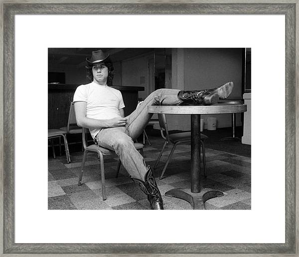 John Travolta, With His Hat And Boots Framed Print