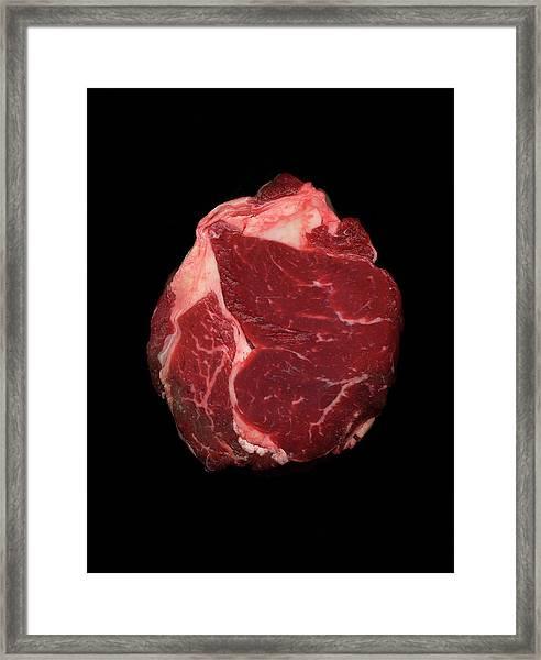Joint Of Beef Against Black Background Framed Print