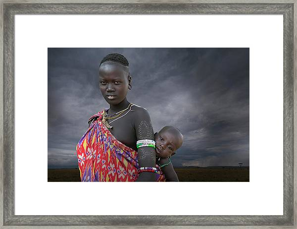 Karo Tribe  Woman With Child Framed Print by Buena Vista Images