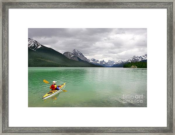 Kayaking In Banff National Park, Canada Framed Print by Oksana.perkins
