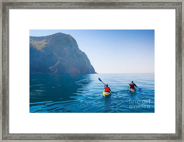 Kayaking In The Sea From Back View Framed Print