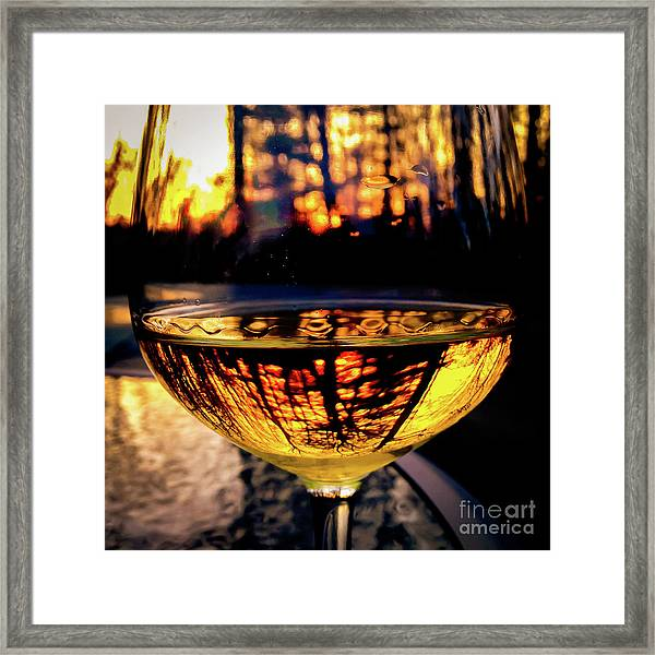Framed Print featuring the photograph Sunset In A Glass by Atousa Raissyan