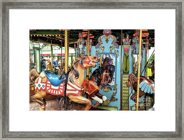 Le Carrousel Colors At Bryant Park In New York City Framed Print by John Rizzuto