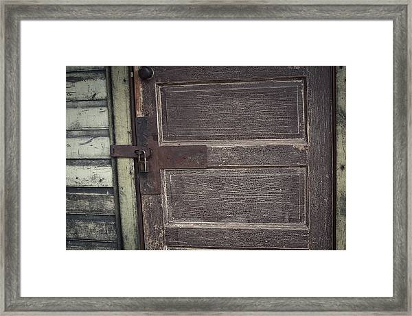 Leather Door Framed Print