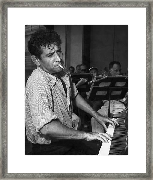 Leonard Bernstein Smoking At Piano Framed Print by Bettmann