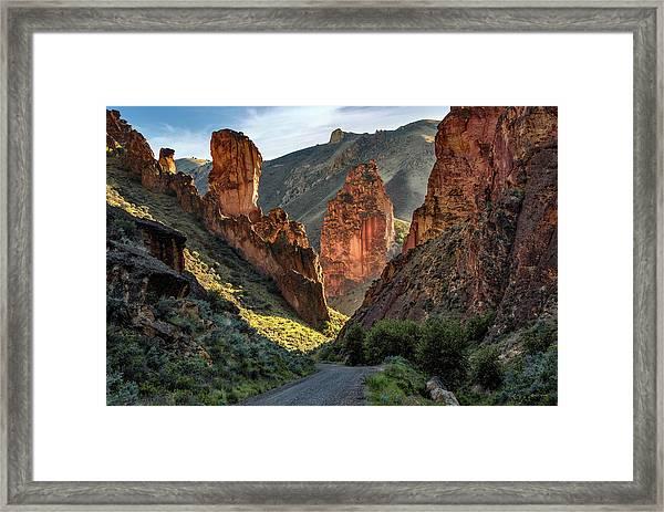 Leslie Gulch Road Framed Print by Leland D Howard