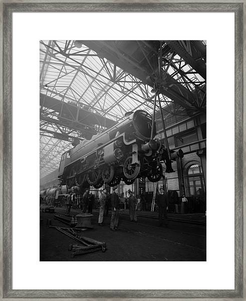 Lifting A Train Framed Print