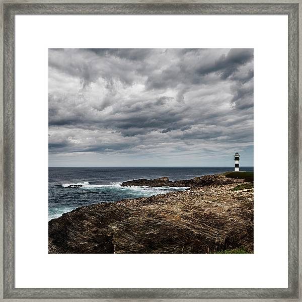 Lighthouse At Isla Pancha Framed Print