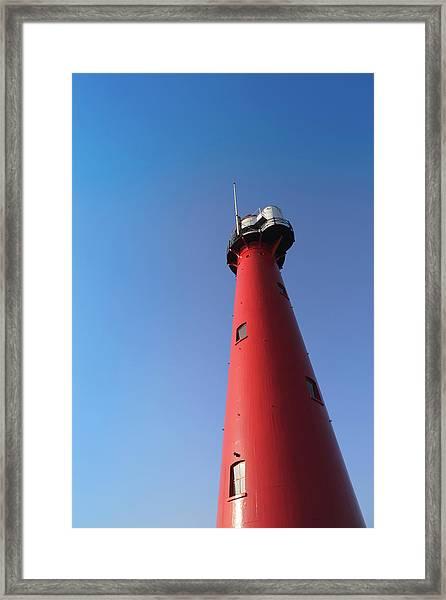 Lighthouse Of Hoek Van Holland Against Framed Print