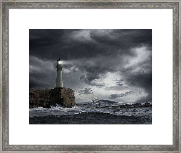 Lighthouse Shining Over Stormy Ocean Framed Print
