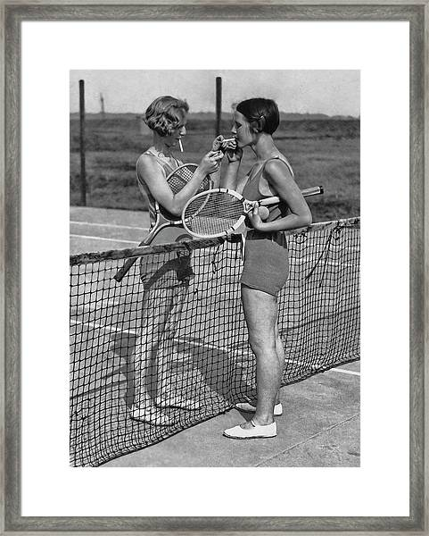 Lighting Up After A Tennis Match Framed Print