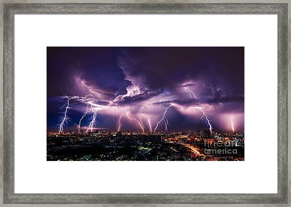 Lightning Storm Over City In Purple Framed Print