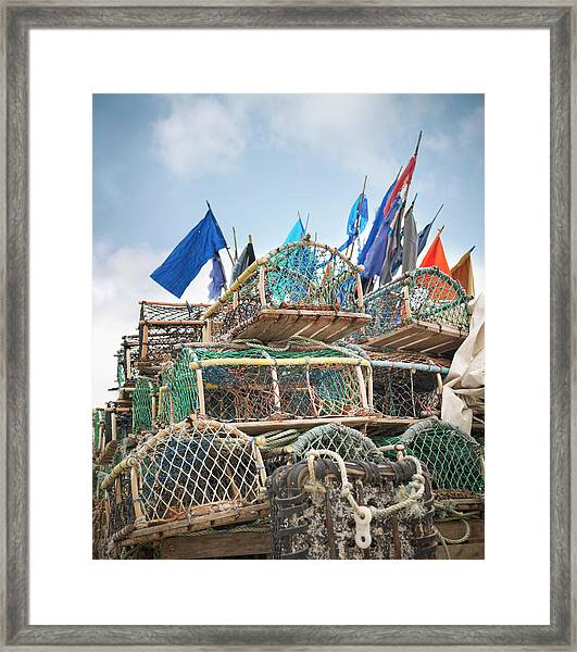Lobster Pots With Flags On Deck Framed Print