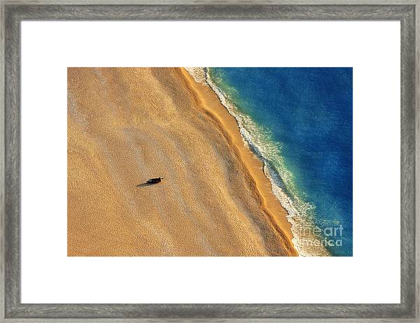 Lonely Boat On A Beach With Aerial View Framed Print