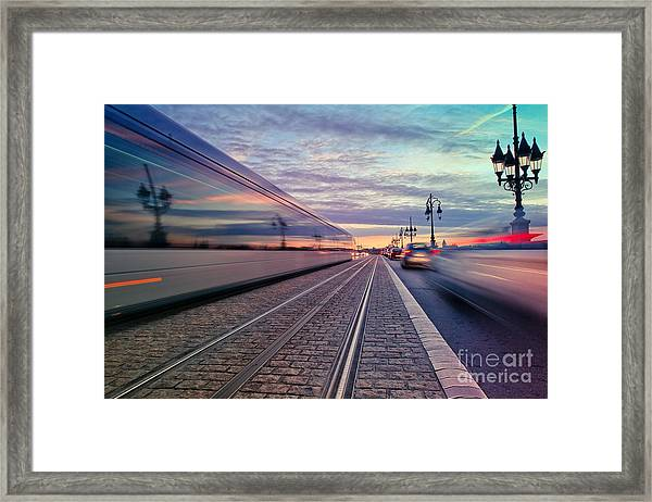 Long Exposure Of A Tram Passing On The Framed Print